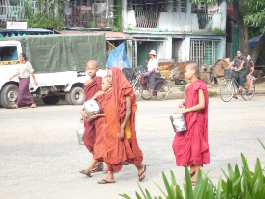 Monks out receiving their daily alms